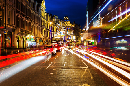 shaftesbury avenue: London, UK - June 18, 2016: Shaftesbury Avenue at night. It is running from Piccadilly Circus to New Oxford Street and is generally considered the heart of Londons West End theatre district