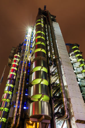 lloyd's of london: London, UK - June 17, 2016: Lloyds building at night. The modern and exceptional Lloyds building, located in the City of London, was designed by architect Richard Rogers and completed in 1986
