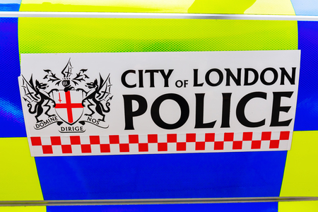 territorial: London, UK - June 18, 2016: sign of the City of London Police at a police car. It is the smallest territorial police force in England and Wales, in terms of geographic area and head-count