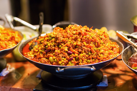 mincemeat: chili con carne in a pan at a street food market