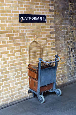 a shopping cart in the wall at platform 9 three-quarter at Kings Cross station in London, UK, referring to the Harry Potter stories