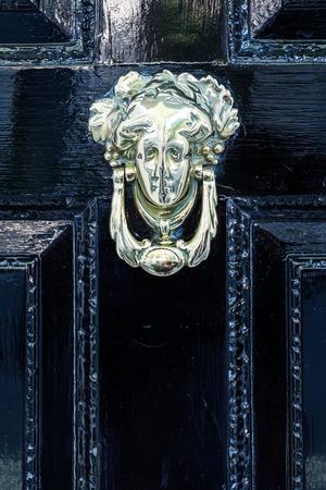 doorknocker: antique doorknocker at an old door in London, UK Stock Photo