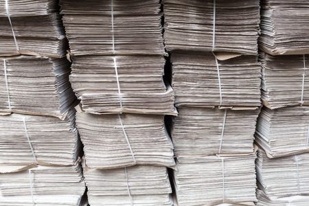 bundles: rows of piled up bundles of newspapers