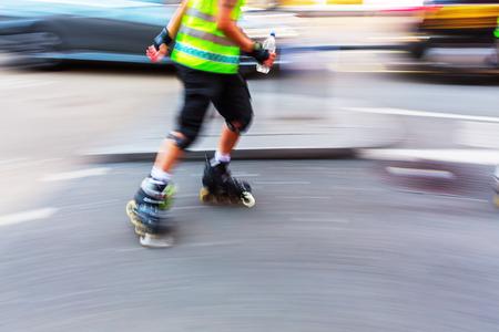 rollerblades: rollerblader on a city street in motion blur