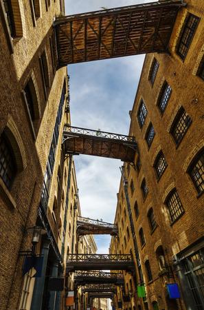 southwark: old alley with footbridges in Southwark, London, UK