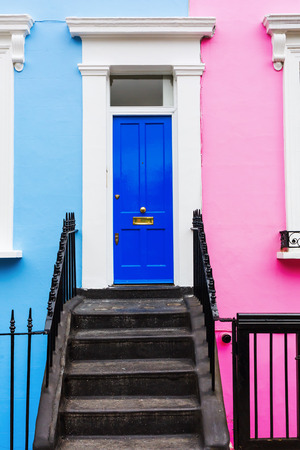 row of houses: colorful typical row houses in Notting Hill, London, UK