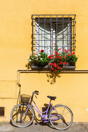 mediterranean house: window of a mediterranean house with bicycle leaning against the wall