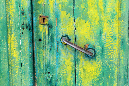 doorlock: decorative old wooden door with green paint Stock Photo
