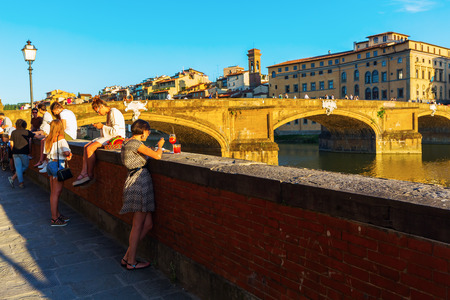 trinita: Florence, Italy - July 03, 2016: city view with unidentified people at Ponte Santa Trinita. Florence was a centre of medieval European trade and finance and one of the wealthiest cities of the time