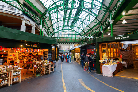 London, UK - June 18, 2016: Borough Market with unidentified people in Southwark, Central London. It is is a wholesale and retail food market, one of the largest and oldest in London