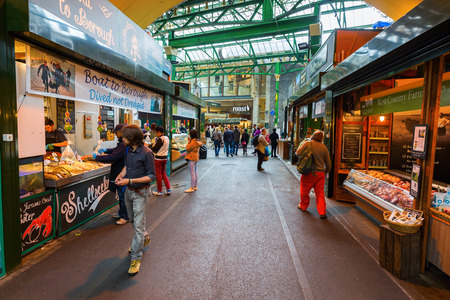 southwark: London, UK - June 18, 2016: Borough Market with unidentified people in Southwark, Central London. It is is a wholesale and retail food market, one of the largest and oldest in London Editorial