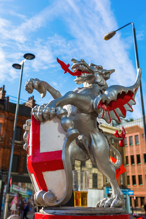 boundaries: London, UK - June 21, 2016: Dragon statue at the Broadgate Tower. The dragon boundary marks are cast iron statues of dragons on metal or stone plinths that mark the boundaries of the City of London Editorial