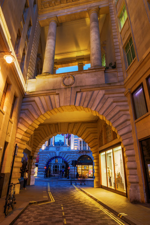 regent: London, UK - June 15, 2016: Archway under historic buildigs to Regent Street in London at night. Regent Street is one of the major shopping streets in the West End of London
