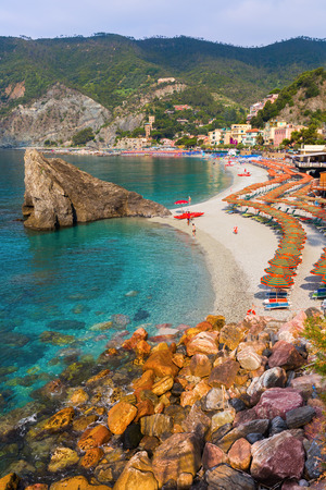 monterosso: Monterosso, Italy - July 02, 2016: beach scene in Monterosso al Mare with unidentified people. Monterosso is one of the famous five UNESCO protected picturesque towns in the Cinque Terre