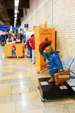 fictional character: London, UK - June 19, 2016: Paddington Bear stall at Paddington station. It is a fictional character, featured in more than twenty books written by Michael Bond, illustrated by Peggy Fortnum and other Editorial