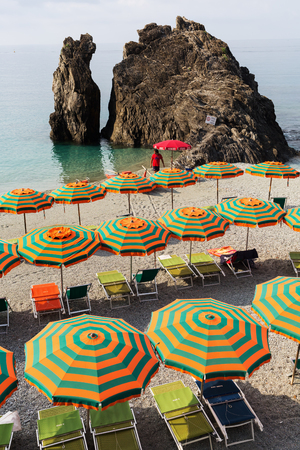 monterosso: Monterosso, Italy - July 02, 2016: beach scene in Monterosso al Mare with unidentified person. Monterosso is one of the famous five UNESCO protected picturesque towns in the Cinque Terre