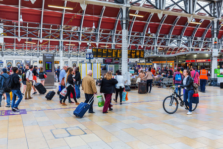 mainline: London, UK - June 19, 2016: London Paddington station with unidentified people. Much of the main-line station dates from 1854 and was designed by Isambard Kingdom Brunel Editorial