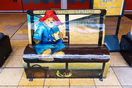 fictional character: London, UK - June 19, 2016: Paddington Bear bench at Paddington station. It is a fictional character, featured in more than twenty books written by Michael Bond, illustrated by Peggy Fortnum and other Editorial