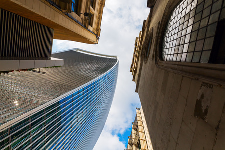 low angles: London, UK - June 17, 2016: skyscraper 20 Fenchurch Street in London, completed 2014, 34-storey and 160 m tall, 12th tallest in London, designed by architect Rafael Vinoly, nicknamed Walkie-Talkie