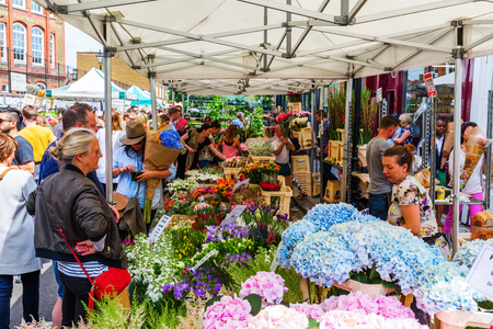London, UK - June 19, 2016: Columbia Road Flower Market with unidentified people. It is a popular historic street market in the London Borough of Tower Hamlets.
