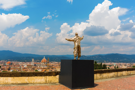 maestro: Florence, Italy - July 06, 2016: golden sculpture at the Forte di Belvedere in Florence. It is a collection of golden sculptures exhibited at three places in Florence, by Belgium artist Jan Fabre Editorial