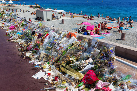 Nizza, France - July 25, 2016: tributes at the Promenade des Anglais with unidentified people. On July 14th, 2016, 85 people were killed by a terrorist who drives a truck in a crowd