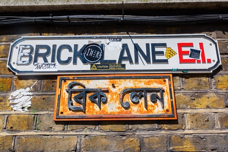 hamlets: London, UK - June 15, 2016: street name sign of Brick Lane. Brick Lane is a street in Tower Hamlets and it is the heart of the citys Bangladeshi-Sylheti community with many curry houses.