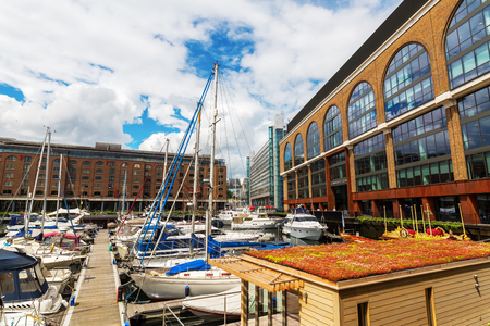 docklands: London, UK - June 15, 2016: St. Katharine Docks with unidentified people. The docks were part of the Port of London in the Docklands, and are now a popular housing and leisure complex