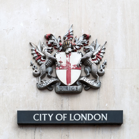 city coat of arms: London, UK - June 15, 2016: coat of arms of the City of London. It is the official coat of arms of the City of London, which is one of a number of cities and boroughs in Greater London.