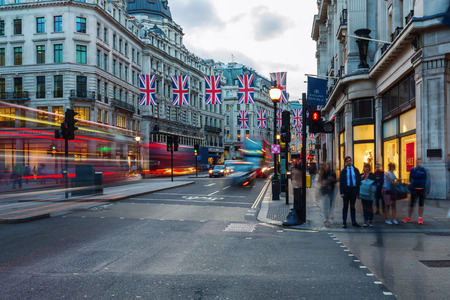 west end: London, UK - June 15, 2016: Regent Street in London at dusk. Regent Street is one of the major shopping streets in the West End of London. Editorial