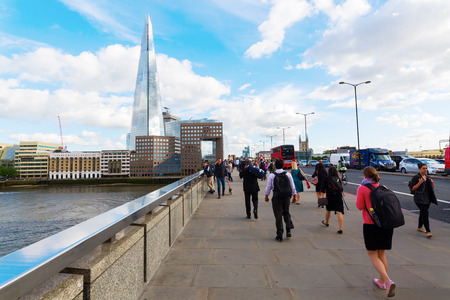 journeying: London, UK - June 15, 2016: unidentified people on the London Bridge. The bridge is often shown in films, news and documentaries showing the throng of commuters journeying to work into the City Editorial