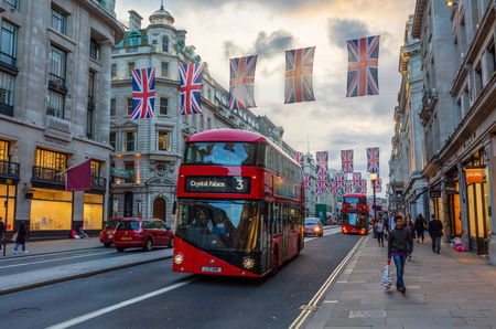 regent: London, UK - June 15, 2016: Regent Street in London at dusk. Regent Street is one of the major shopping streets in the West End of London. Editorial