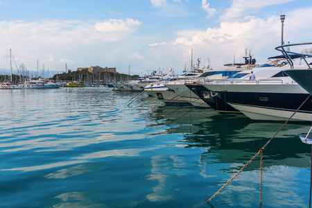 azur: Antibes, France - July 24, 2016: boats in the harbor of Antibes with unidentified people. Antibes is a Mediterranean resort in the Alpes-Maritimes department of southeastern France, on the Cote d Azur Editorial