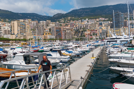 Monaco, Monaco - July 30, 2016: boats in the harbor of Monaco with unidentified person. Monaco is the 2nd smallest country in the world, popular by the rich because of its tax policy Editorial
