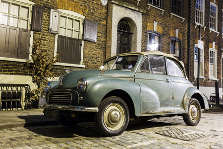morris: London, UK - June 19, 2016: Morris Minor Convertible car at night. It is a British historical car. More than 1.3 million were manufactured between 1948 and 1972 in three serie