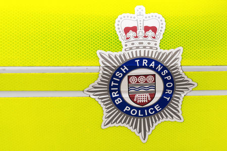 btp: London, UK - June 21, 2016: logo of the British Transport Police on a police car. The BTP is a special police force that polices railways and light-rail systems in England, Scotland and Wales