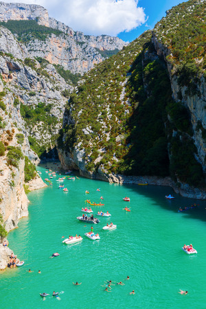 a bathing place: Les Salles sur Verdon, France - August 01,2016: Lac de Sainte Croix and entrance of the Verdon canyon and unidentified people. The canyon is one of the biggest in Europe and very popular with tourists