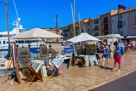 jetset: Saint Tropez, France - August 03, 2016: view in the harbor of Saint Tropez with unidentified people. St Tropez is a seaside resort at the Cote dAzur and popular for the European and American jet set