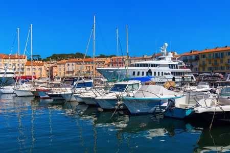 tropez: Saint Tropez, France - August 03, 2016: view in the harbor of Saint Tropez. St Tropez is a seaside resort at the Cote dAzur and popular for the European and American jet set Editorial