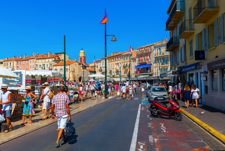 tropez: Saint Tropez, France - August 03, 2016: view in the harbor of Saint Tropez with unidentified people. St Tropez is a seaside resort at the Cote dAzur and popular for the European and American jet set