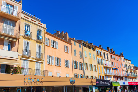 Saint Tropez, France - August 03, 2016: buildings at the harbor of St Tropez. St Tropez is a seaside resort at the Cote dAzur and popular for the European and American jet set