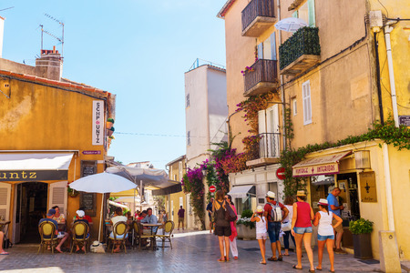 jetset: Saint Tropez, France - August 03, 2016: in the old town of Saint Tropez with unidentified people. St Tropez is a seaside resort at the Cote dAzur and popular for the European and American jet set Editorial
