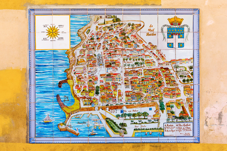 azur: Antibes, France - July 24, 2016: city map of Antibes on wall tiles. Antibes is a Mediterranean resort in the Alpes-Maritimes department of southeastern France, on the Cote d Azur