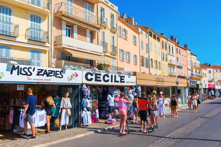 Saint Tropez, France - August 03, 2016: shops at the harbor of Saint Tropez with unidentified people. St Tropez is a seaside resort at the Cote dAzur and popular for the European and American jet set