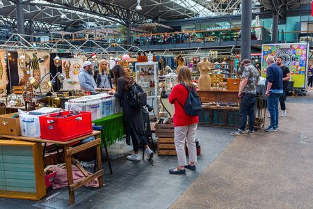 hamlets: London, UK - June 16, 2016: Covered Old Spitalfields Market in Tower Hamlets with unidentified people. There has been a market on the site for over 350 years. Editorial