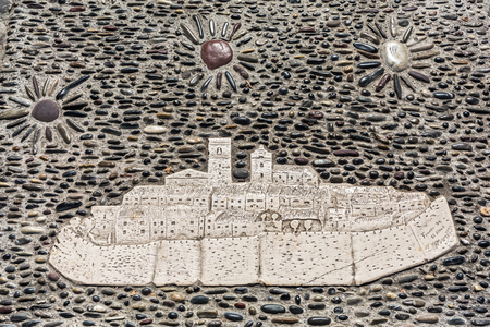 vence: Saint-Paul-de-Vence, France - August 04, 2016: artistic mosaic of the town on pebble pavement. The town is one of the oldest medieval ones on the French Riviera, also well known for its art galleries