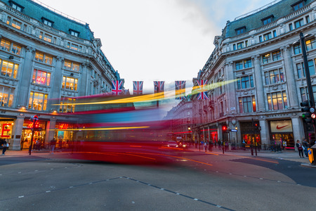 London, UK - June 16, 2016: traffic at Oxford Circus at dusk, with unidentified people. Up to over 40.000 pedestrians per hour pass the junction, its the highest pedestrian volumes recorded in London Editorial