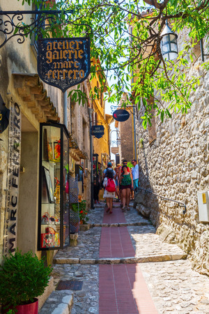 maritimes: Eze, France - August 04, 2016: alley in the medieval village of Eze with unidentified people. Eze, renowned tourist site on French Riviera, is famous worldwide for the view of the sea from hill top Editorial