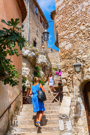 renowned: Eze, France - August 04, 2016: alley in the medieval village of Eze with unidentified people. Eze, renowned tourist site on French Riviera, is famous worldwide for the view of the sea from hill top Editorial