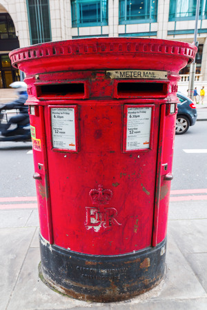 royal mail: London, UK - June 18, 2016: antique pillar mailbox of the Royal Mail. Royal Mail is a postal service company in the UK, originally established in 1516